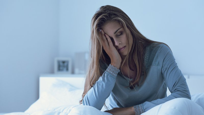 woman with fatigue having difficulties when waking up